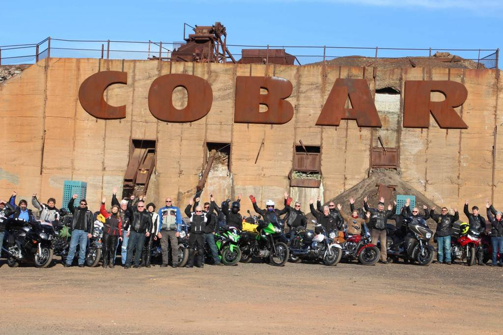 The NSW Black Dog riders photo shoot at the Cobar sign on Monday morning.