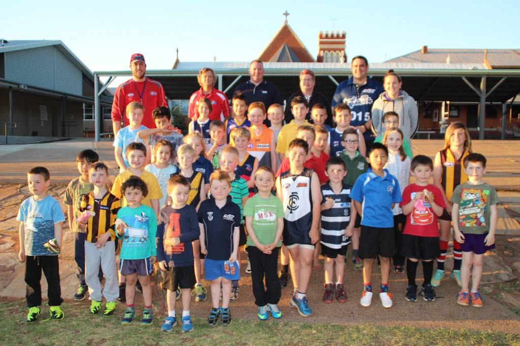 "The Cobar Junior AFL Auskick season came to an end last Friday with juniors playing their final games before presentations and a sausage sizzle. This year's competition ran over four months and involved 10 Auskick sessions with 51 juniors taking part. Auskick coordinator Denver D'Angelo said while registrations were slightly less than last year, attendance each week had been a lot more  consistent which he attributes to the team captains. ""It was great for the kids as you could see them learning more this year,"" Mr D'Angelo said. He praised CB Tyres for helping keep the balls pumped up, the volunteers that helped each week with first aid and cooking the sausage sizzles and also the Cobar Blues Football & Netball club for supporting the program this year. Pictured above at St John's School oval is the group of young players with their team captains/coaches Thomas Lethbridge and Joanne Summerville, sponsors Michael Ware from Atlas Copco and Jacquie Huddleston from Country Simplicity, coordinator Denver D'Angelo and  captain/coach Bianka Jacobson. (Absent from the photo was one of the team captain/coaches Tom Edgar.)"