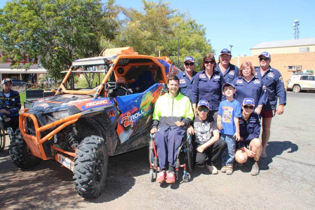 Quadriplegic Chad Graham finished his 4,800km off road journey across Australia in his modified buggy in Cobar on Saturday morning. Chad is pictured with his support crew of family and friends at a welcome barbecue hosted by M&C Parisi Motorcycles.