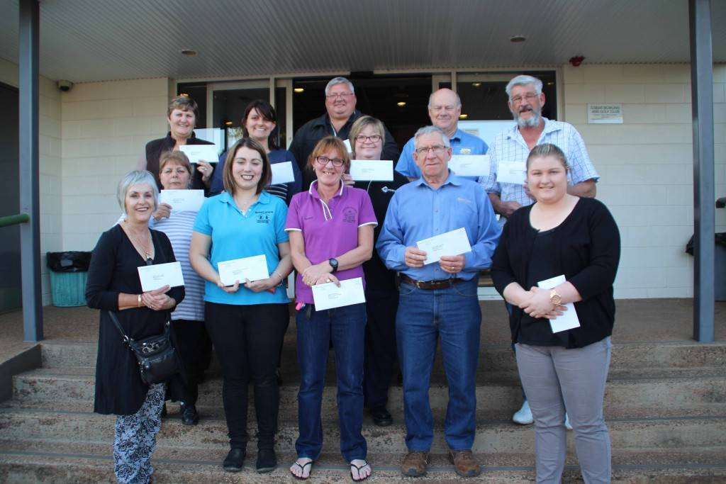 Cobar Bowling & Golf Club secretary/manager Demi Smith (at front far right) handed out ClubGrants donations to representatives of 13 local groups last Friday.