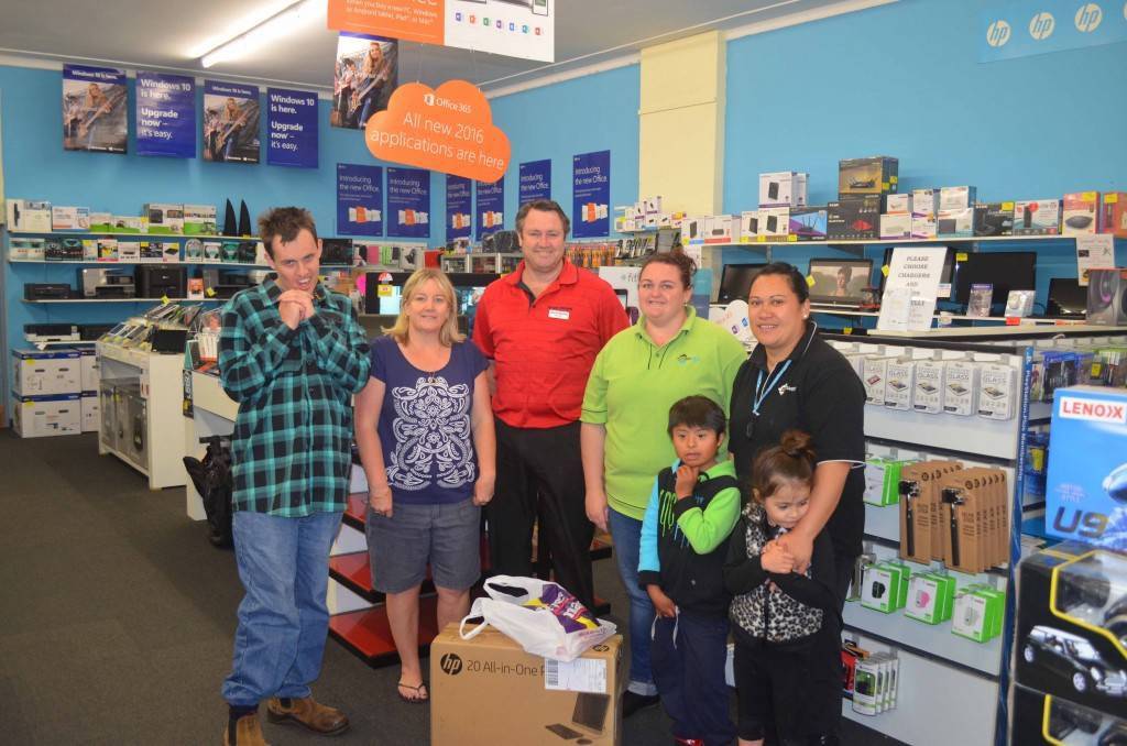 Carewest Yarrabin staff and clients took delivery of a new desktop computer from Harvey Norman last week purchased with a donation from the Intermine Golf  Challenge. Carewest client Mark Madden, Intermine Golf Challenge committee  member Donna Prendergast, Harvey Norman Cobar franchisee Shawn Murphy, Carewest staff Rachel Burns and Myshelle Gillette and clients Daniel Apaza and  Hazel Rauahi were on hand to pick up the new computer. Carewest wrote to the  Intermine Golf challenge seeking funds for their clients who range from 0-64 years of age. The challenge raised funds to assist a number of different organisations  including the 000 Heroes Ball, Little Athletics, Cobar Swimming Club, Cobar Public School P&C, Cobar Bowman Club and the Peak Skate Park. ▪ Photo contributed