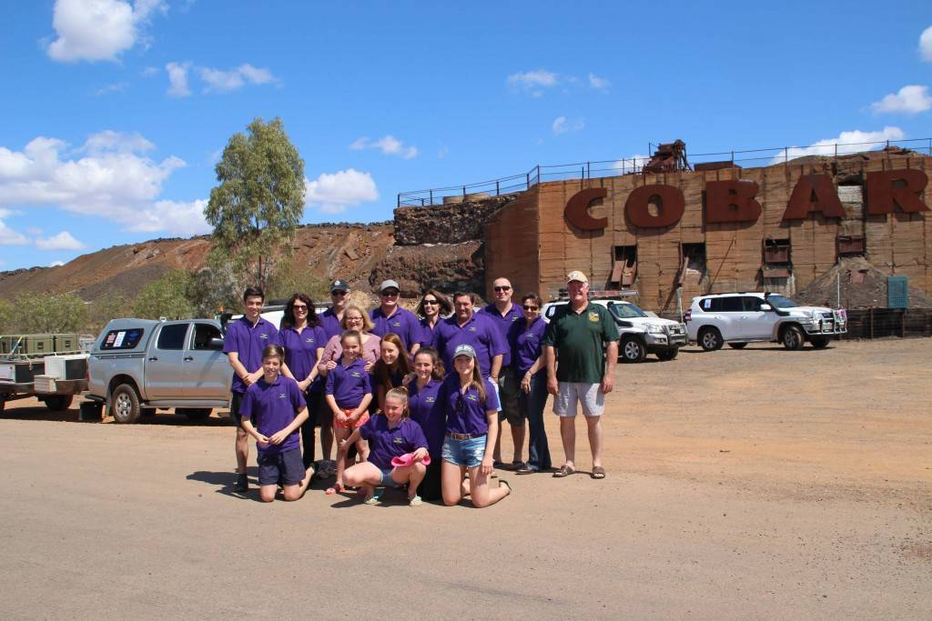 Some of the 'Cobar Crew' on this year's Bourke Police & Community Outback Trek at the Cobar sign on Saturday morning before they headed off for their 13 day adventure.