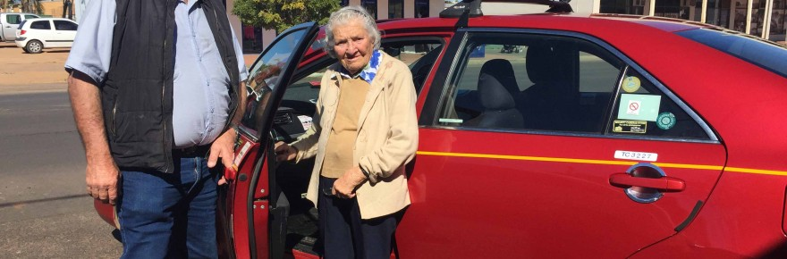Local taxi driver Ray Wilson with Home Care client Peg Coughlan on Monday.