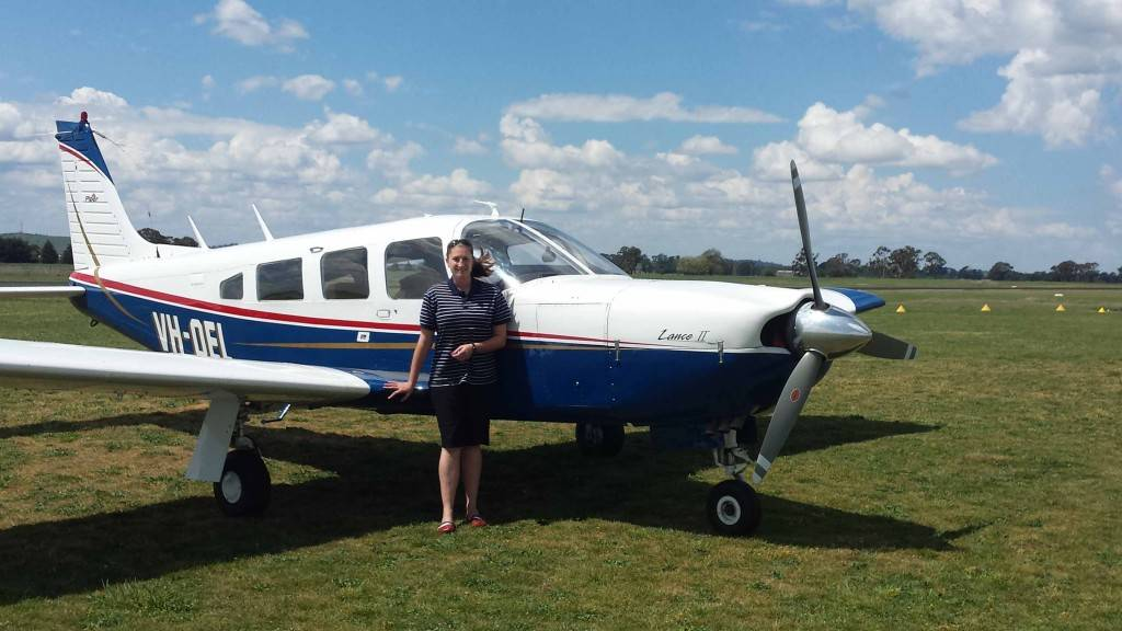 AWI Consulting's Angela Webb is planning to offer outreach services to clients using their recently purchased Piper Lance plane. ▪ Photo contributed