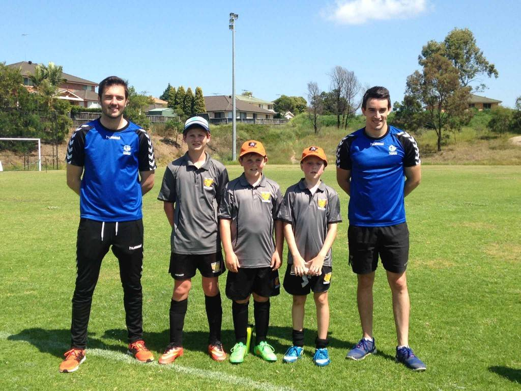 Benjamin Anderson, Sam Piper and Chad Buckman spent the last week of the school holidays with the FWAS Soccer squad in Sydney. They are pictured with soccer player David Plowright and Football NSW coach Anthony Herrera, who they trained with.