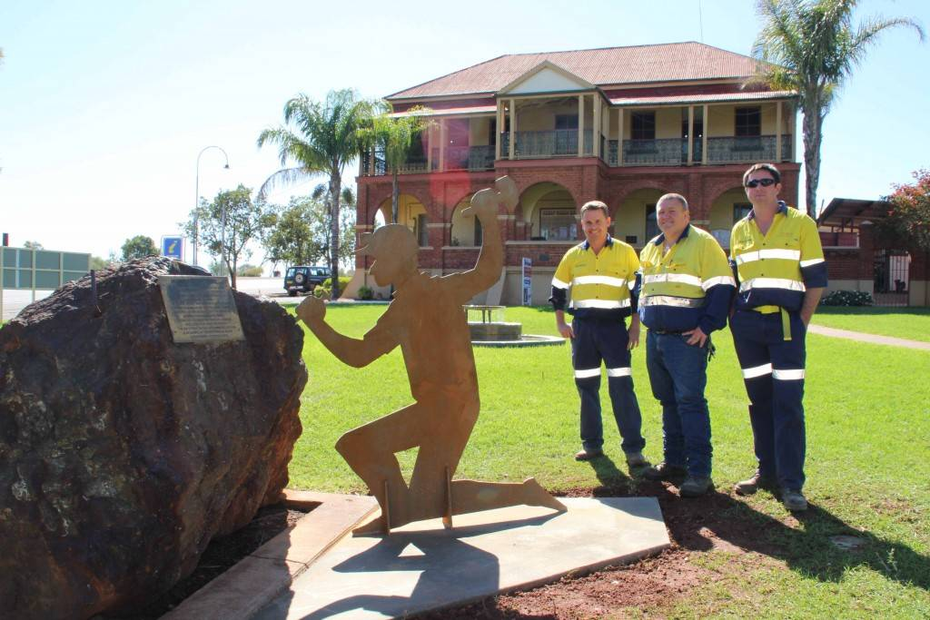 In preparation for this year's Festival of the Miner's Ghost Peak Gold Mines staff have been erecting cut outs of miners around the museum and 'COBAR' sign at the Cornish Rest Area. Pictured are Dale McLeod, Tom Martin and Chris Higgins at the Great Cobar Heritage Centre last Friday.