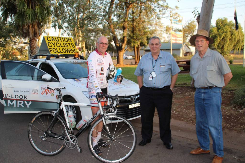 Tour de OROC chairman David Hayes with Cobar Shire Council's general manager Gary Woodman and deputy mayor Peter Abbott at the caravan park on Tuesday.