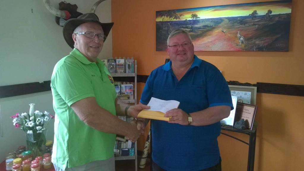 As a show of appreciation for their warm Cobar hospitality last week, the Ulysses RV Club members made a donation to the Copper City Men's Shed. Pictured is Ulysses member Rick Bedford with Tony Punzet from the Men's Shed. ▪ Photo contributed