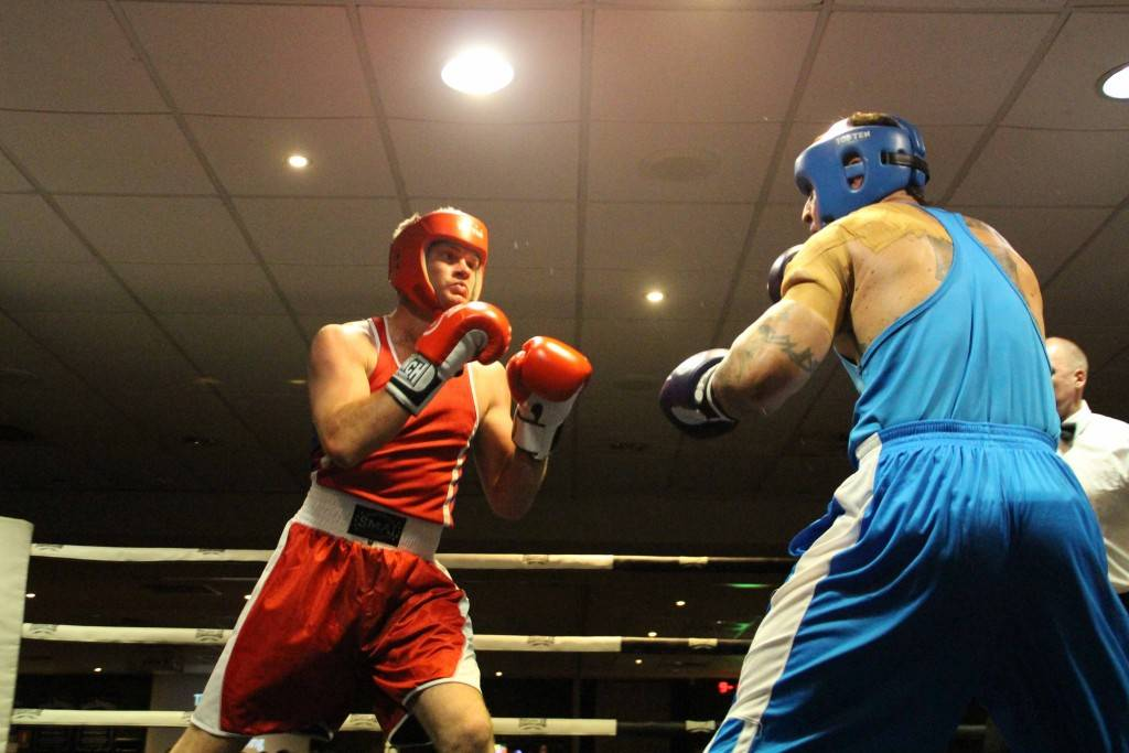 Despite not winning his bout, local fighter Chris Deighton (at left) was a real crowd pleaser at Fight Night at the Cobar Bowling & Golf Club on Saturday.