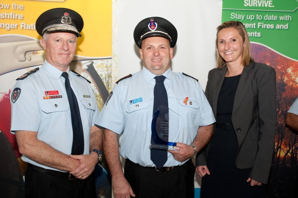 Fire & Rescue NSW Commissioner Greg Mullins presented Cobar Fire Station Captain Brad Lennon with a 'Best Management of a Workplace Injury' award recently at the 2015 Commissioner's Safety Awards. Employers Mutal Ltd representative Amber Addicott also shared in presenting this the award to Mr Lennon. ▪ Photo contributed