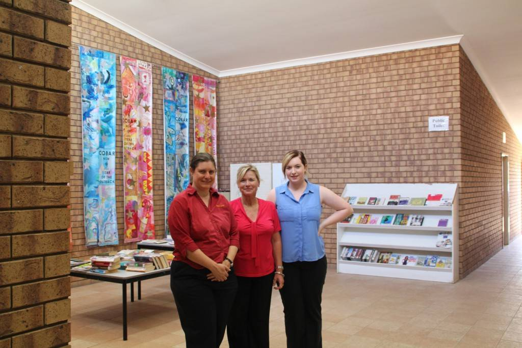 Cobar Shire & TAFE Library services manager Jane Siermans and her staff Janet Place and Emily Ham in the library alcove area which they hope will soon become an enclosed space.