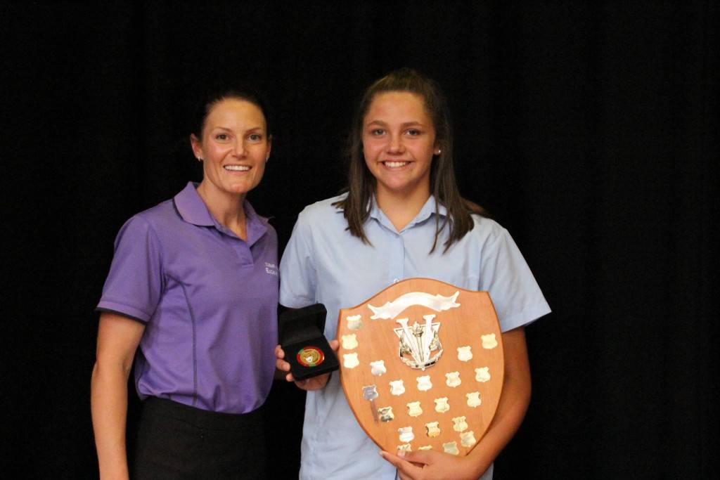 Cobar High School Head PD/H/PE teacher Amie Hill presented Year 7  student Hannah Carroll with the Bill and Chatie Prisk Memorial Award for the Most Outstanding Sportsperson in 2015 at the school's awards ceremony recently. Hannah was also presented with a Western Region Representation NSW CHS State Athletics medal after winning her discus event at this year's  high schools state athletics carnival.