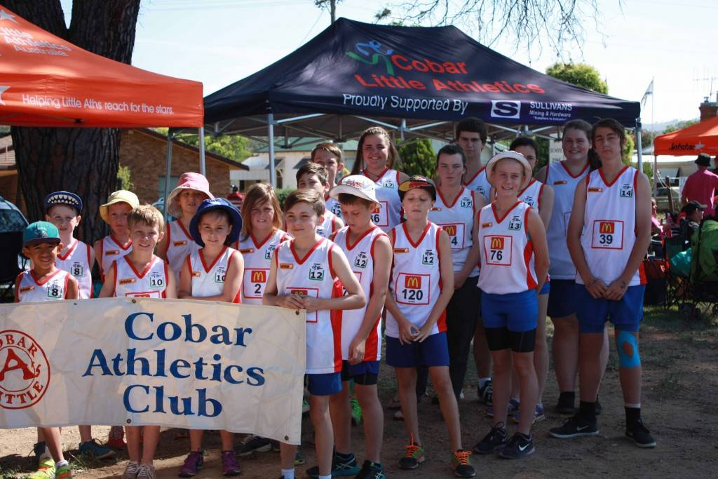 The Cobar Athletics Club squad of 23 at the LAANSW Zone Track and Field Championships carnival in Wellington recently. ▪ Photo contributed