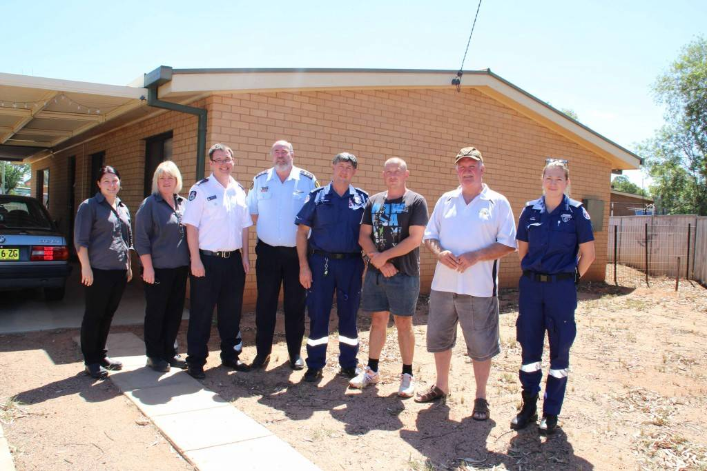 The Cobar community has rallied behind local paramedic Tony Cremona and his family after they lost their home and contents in a fire last week. Pictured are Endeavor staff Rachael Garland and Jackie Smith with Daniel Gordon (RFS), Graeme Craig (SES), Stephen Dutton (Ambulance Service), Mr Cremona, Greg Martin (Police) and Kate Holzheimer (Ambulance Service).