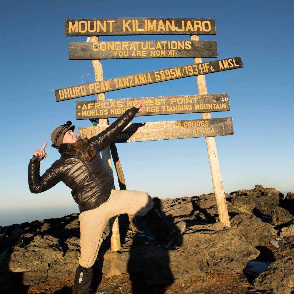 Local Brock Martin will attempt to climb Mount Aconcagua in South America next month. He is pictured above at the top of Mt Kilimanjaro, a summit he climbed last year. ▪ Photo contributed