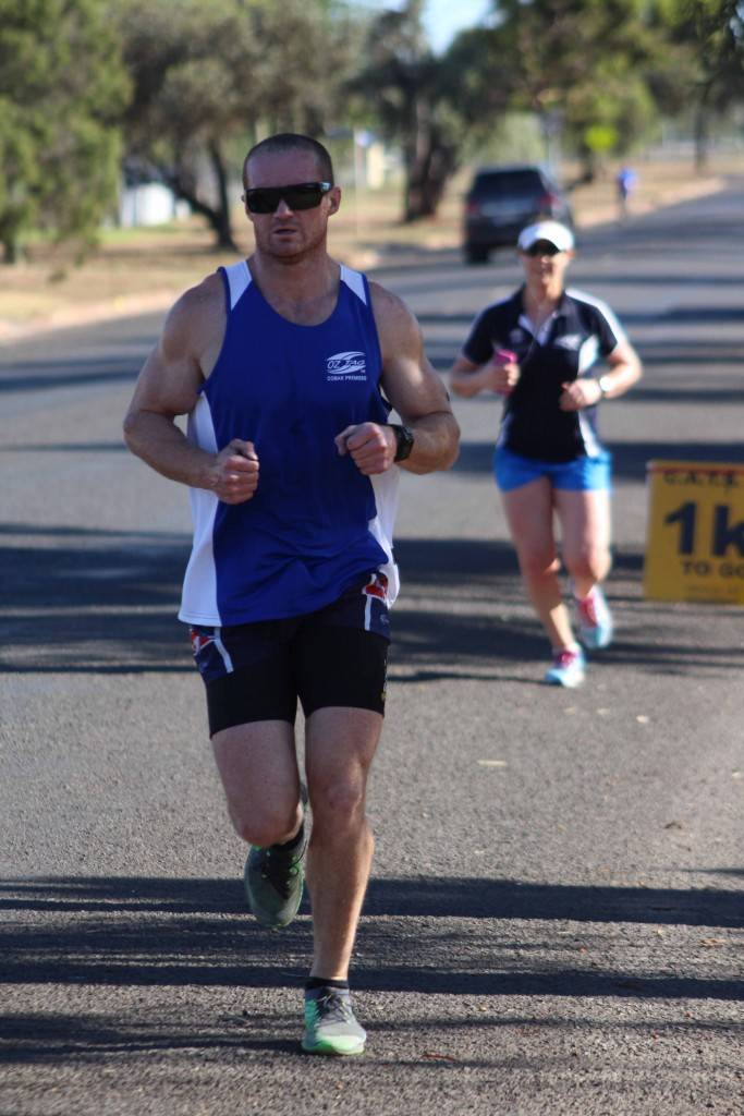 The overall handicap winner of the CATS' January triathlon Alistair Travis with second placed Pip O'Donnell just behind during the long course run leg up Woodiwiss Avenue on Sunday morning.