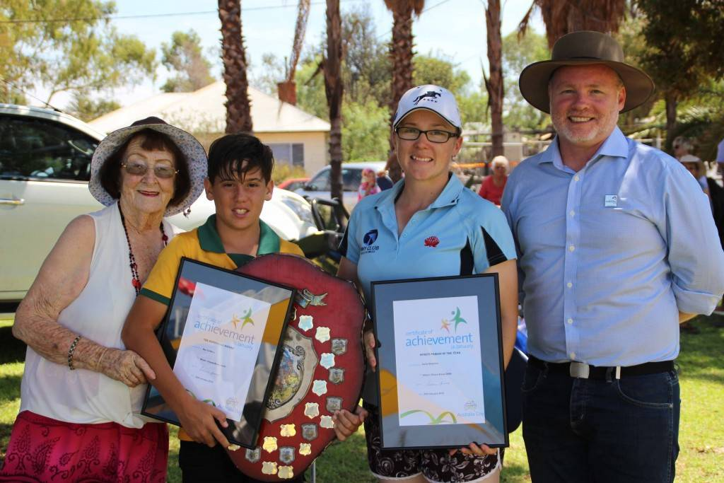 Mayor Lilliane Brady and 2016 Australia Day ambassador Andrew Heslop (at far right) with sports awards winners Ben Griffiths (Kerrigundi Award) and Kaila Wharton (Sports Person of the Year) at the Cobar Memorial Swimming Pool yesterday.