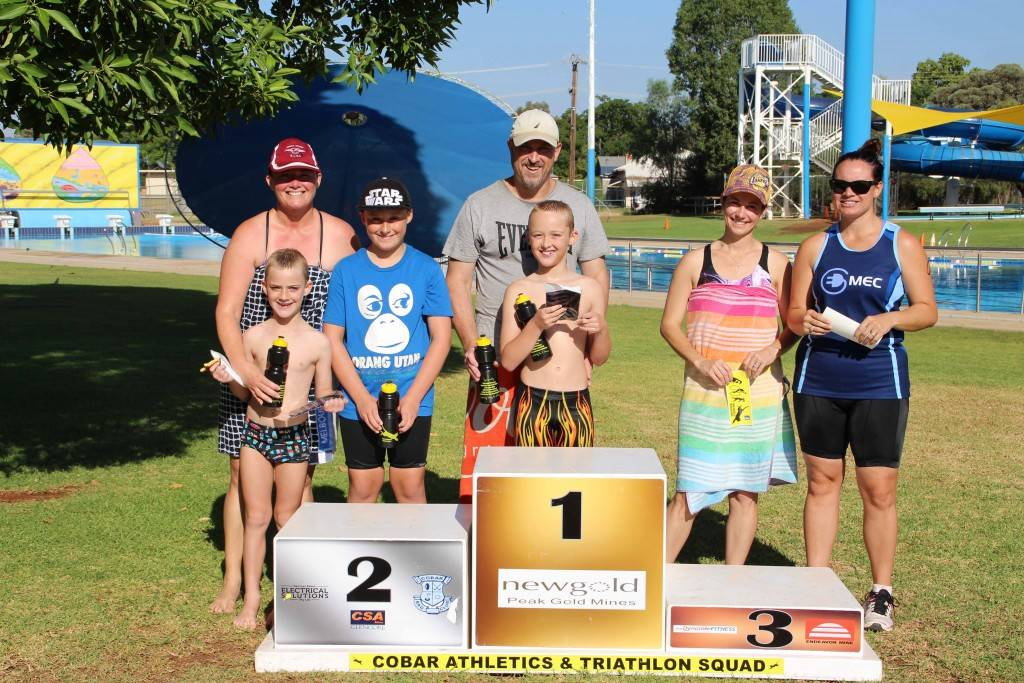 The CATS February triathlon winners of the handicapped teams event were: 1st—Adam and Byron Lynch (at centre), 2nd—Kylie and Noah Lynch (at left with youngest family member Jacob who cheered them on) and 3rd—Tanya Gilbert and Nikki Davey (at right).