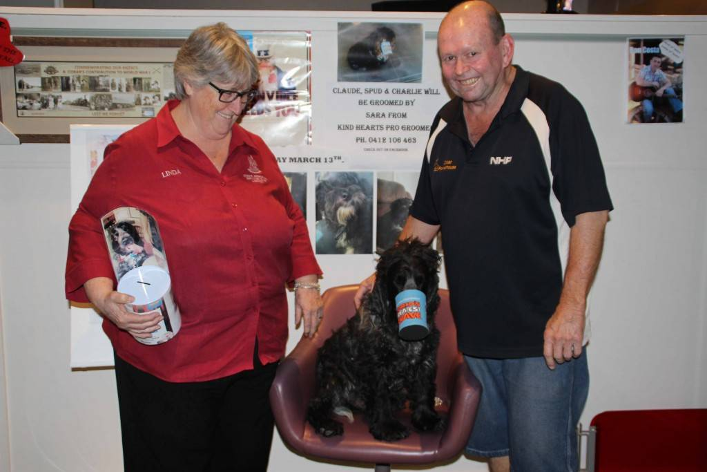 Cobar Memorial Services Club secretary/manager Linda Carter is pictured with club president Gary Middleton and his dog Claude who will be going under the clippers for 'Shave for a Cure' fundraiser.