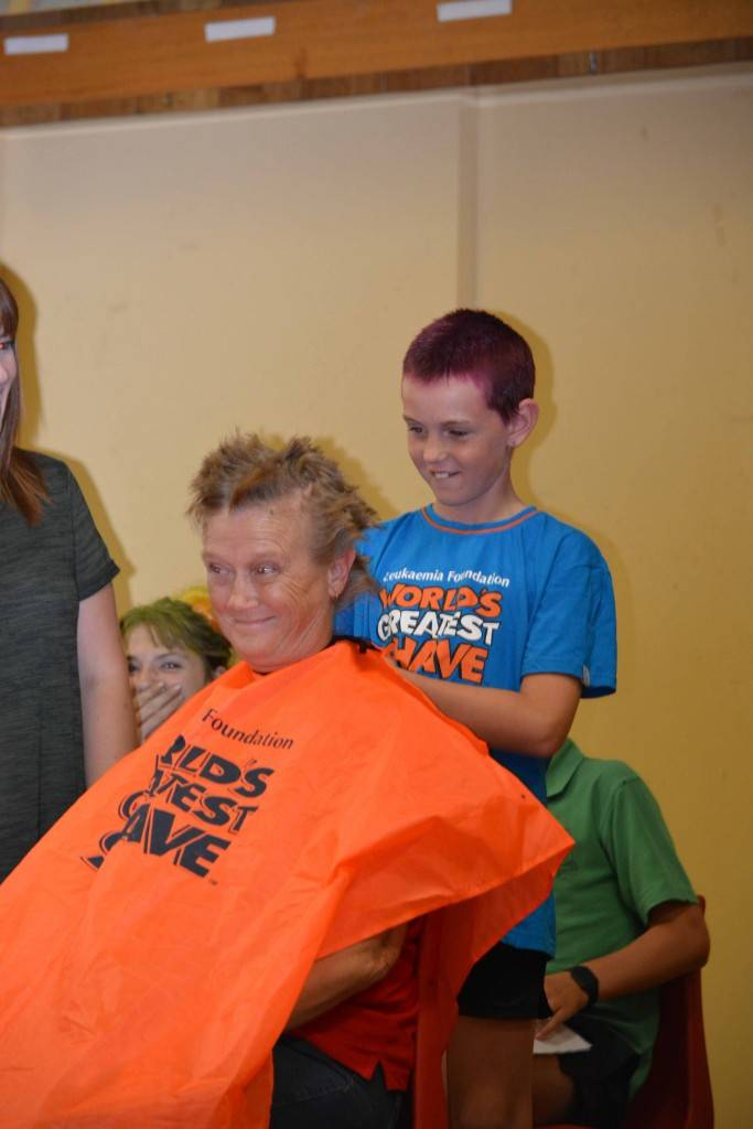 Cobar Public School teacher Jo Sommerville had her head shaved by student Lilly-Rose Hunt (who also recently lost her locks for charity) at the school's World's Greatest Shave on Friday.