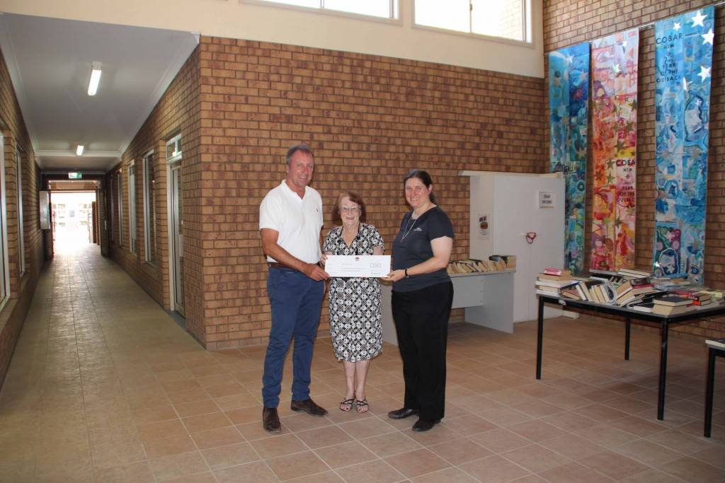 State Member for Barwon Kevin Humphries presented Mayor Lilliane Brady and Cobar Shire & TAFE Library manager Jane Siermans with a cheque on Saturday.
