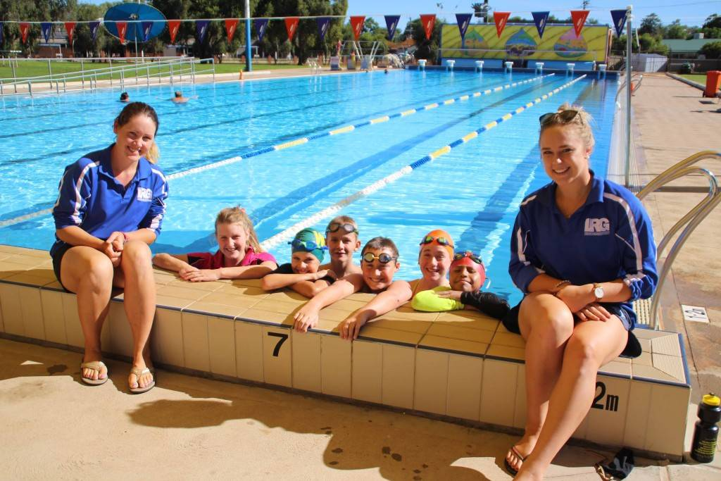 Local swimming coaches Stephanie Baker and Georgia Baker (far right) with State swimmers Makaila Gordon, Luke Guirin, Raymond Jones, Noah Lynch, Ruby-Belle Stingemore and Jair Apaza at a training session last Tuesday afternoon.