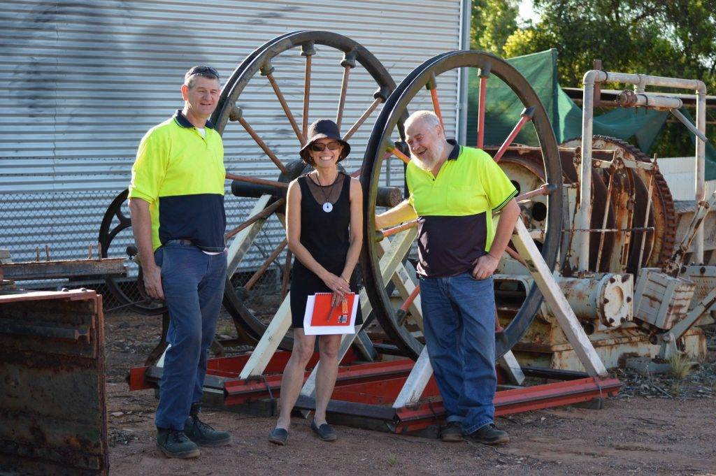 Mark Ryland and Michael Silburn of the Geoscience Centre with museum curator Kay Stingemore with the winder wheels which have been donated to the museum.