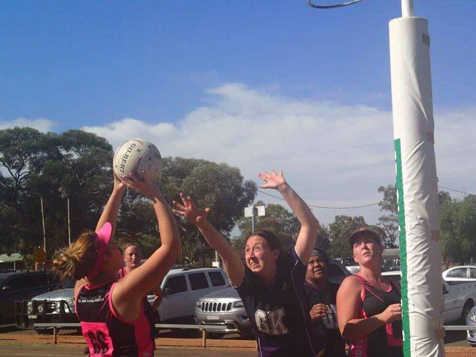 Hot Shots' shooter Gabbi Lennon being defended by Casey Piggott from The Mystics in Saturday's Cobar Netball Association B Grade competition