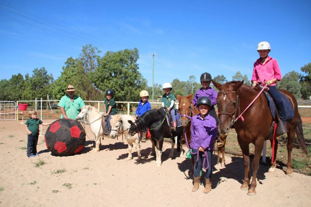 Cobar Pony Club's new and younger members and their horses were introduced to Horse Soccer at the club's rally day on Sunday at Dalton Park Horse Sports Complex. Pictured are Xavier Quale (on Frankie), Charlie Nicholson (Peanut), Lara Stephens (Boots), Katie Nicholson (Spanner) with Sarah Nicholson leading and Georgia Boland on Dusty. Also pictured are club president David 'Crockett' Brown and Sonny Stephens. Horse soccer is a way for riders learn handling skills in a fun way.