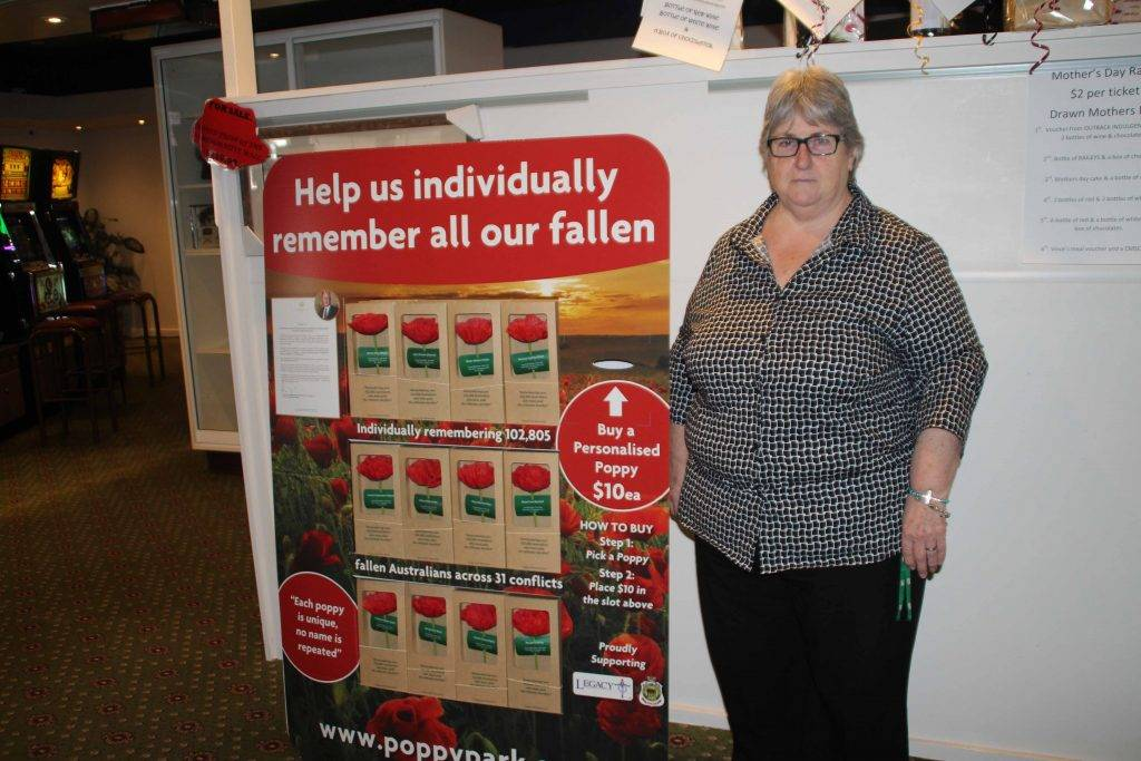 The Cobar Services Club is currently selling ANZAC Day poppies which pay tribute to the men and women who lost their lives serving their country in war. Each poppy is  labelled with the name of a person who died in World War I or World War II and tells their personal story. Secretary/manager Linda Carter is pictured with the club's display.