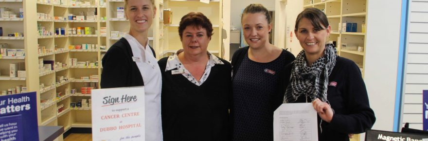 The John Mitchell Pharmacy is one of the many places in town where the public can sign a petition to show their support for a cancer centre at Dubbo Hospital. Shown above with the petition are Pharmacist Shannon Eves with pharmacy employees Diane Slater, Chloe Neumann and Michelle Chandler.