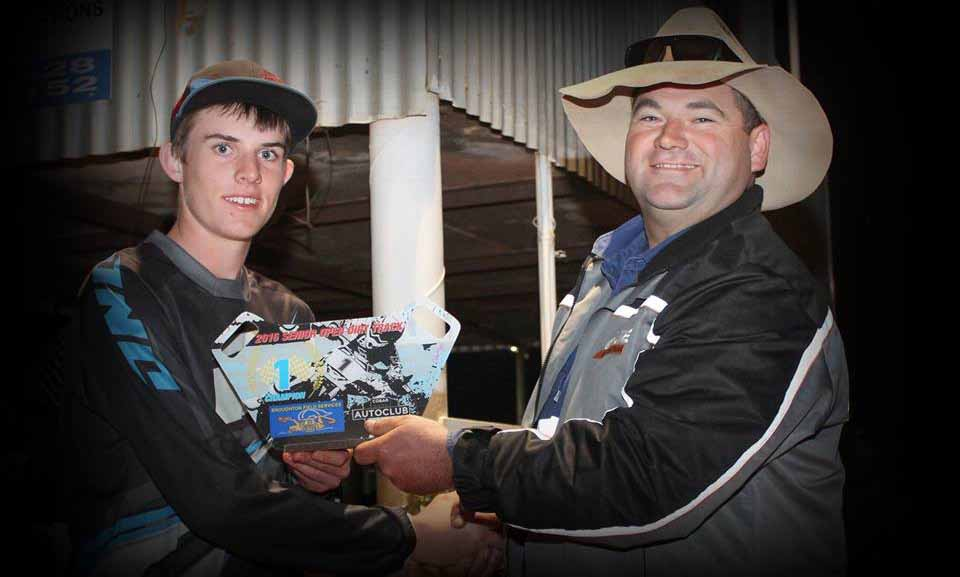 Sponsor Ben Broughton (at right) presented Aiden Porter with the Junior Lites class Tri  Series trophy at the Cobar Auto Club's flat track event on Saturday night. ▪ Contributed