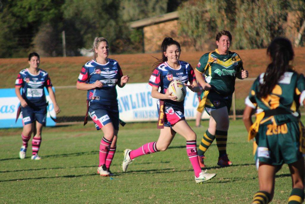 Cobar Roosterettes' Brianna Watson scored arguably the try of the game after a dummy pass against Bourke in the League Tag match on Saturday at Tom Knight Oval.