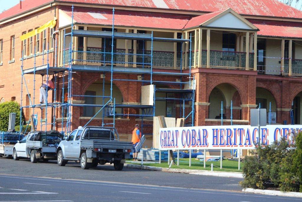 Scaffolding was erected on Monday on the front of the Great Cobar Heritage Centre marking the start of restoration works on the century-old  building's verandah.