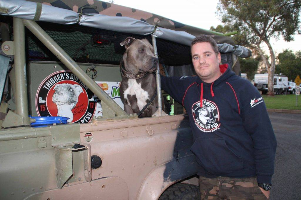 Former Australian Army soldier Royce Hardman and his dog Trigger stopped in Cobar at the caravan park on Monday night on their way through to Queensland.