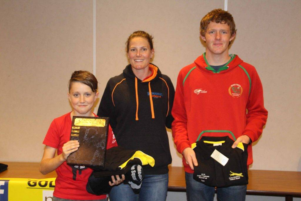 Chad Buckman (left) was named the 2015/2016 Junior Athlete of the Year at the Cobar Athletics & Triathlon Squad (CATS) club's end of season presentation night on Friday at the Cobar Bowling & Golf Club. Chad is pictured with Amie Hill from JKM Dynamic Fitness, a club sponsor, and the junior runner-up Thomas Jones.