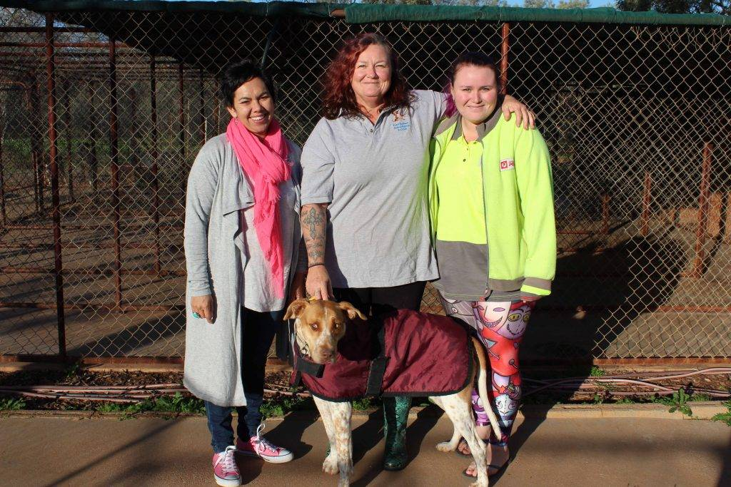 ROAR volunteers Leah Josephson, Wizzy Knezevic and Casey Vidot with one of the  organisation's rescued dogs, Sweetpea Sunday.