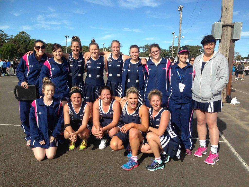 Cobar netball coach Amie Hill (and coaching assistant Tanya Gilbert second from right) with the Cobar Opens team at the Netball NSW State Championships at Charlestown after Cobar's first win of the competition against Tamworth on Saturday.