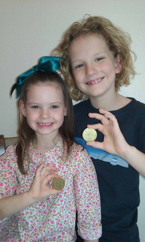 On a recent visit to Cobar eight year old Jarrah Mahoney and his six year old sister Elodie added $5 and $10 Cobar Quids to their coin collections. ▪ Photo contributed