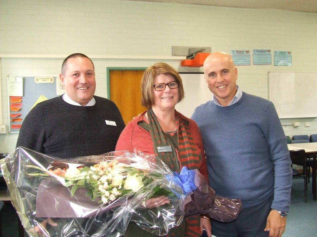 Cobar High School co-principal Shane Carter joined Minister for Education The Hon. Adrian Piccoli in wishing Sue Francisco all the best in her upcoming retirement at a morning tea yesterday at Cobar High School. ▪ Photo contributed