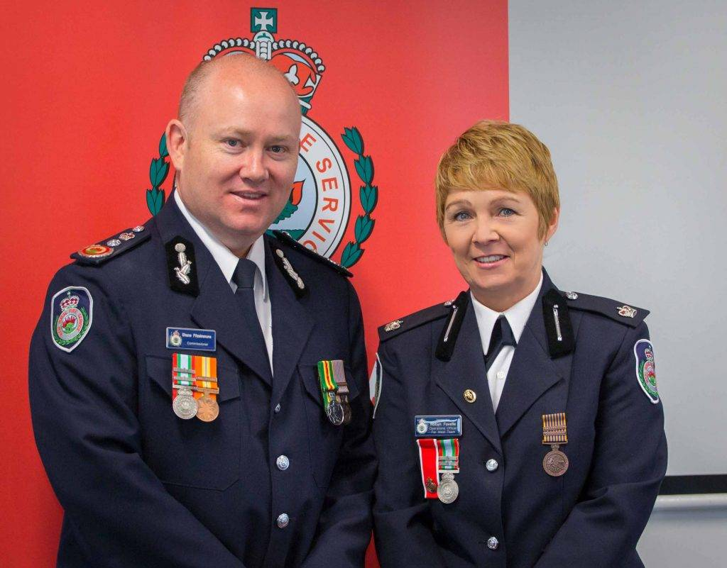 Rural Fire Service Commissioner Shane Fitzsimmons presented Far West Team  Inspector Robyn Favelle with a Long Service Medal 3rd Clasp at a ceremony in Orange last week in recognition of 41 years of service to the RFS. ▪ Photo contributed