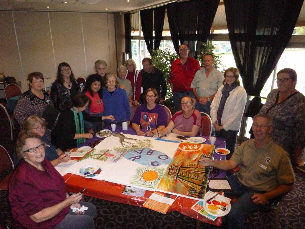 RichmondPRA hosted a Community Art Therapy Session last Wednesday at the Cobar Bowling & Golf Club with a good turnout of attendees. RichmondPRA Community Arts Coordinator, Jane Miller (seated in the centre), flew in from Sydney to instruct and encourage the participants to find their inner artist and express it on canvas. The art will be on display in RichmondPRA's head office at Sydney Olympic Park in  August for the official launch of RichmondPRA's new name 'Flourish Australia'. The art will then return to Cobar to be put on display at a local venue.