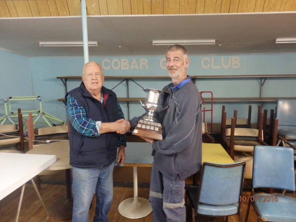 Garry Jones presented the Beryl Jones Memorial trophy to Brad Kendrick on  Sunday at the Cobar Clay Target Club.  ▪ Photo contributed