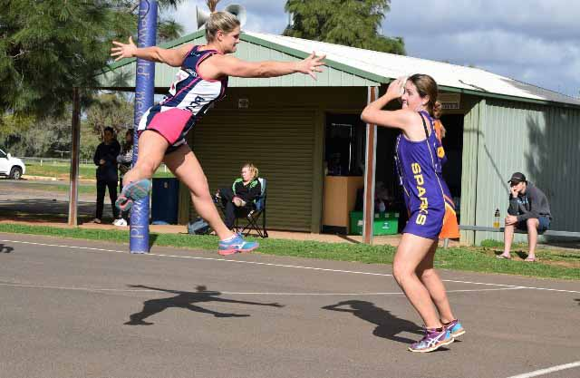 Exceptional defence from Opens' Kaitlyn Clark made things difficult for Stephanie Baker (SPARKS) in Saturday's Cobar Netball Association A Grade semi final. ▪ Contributed