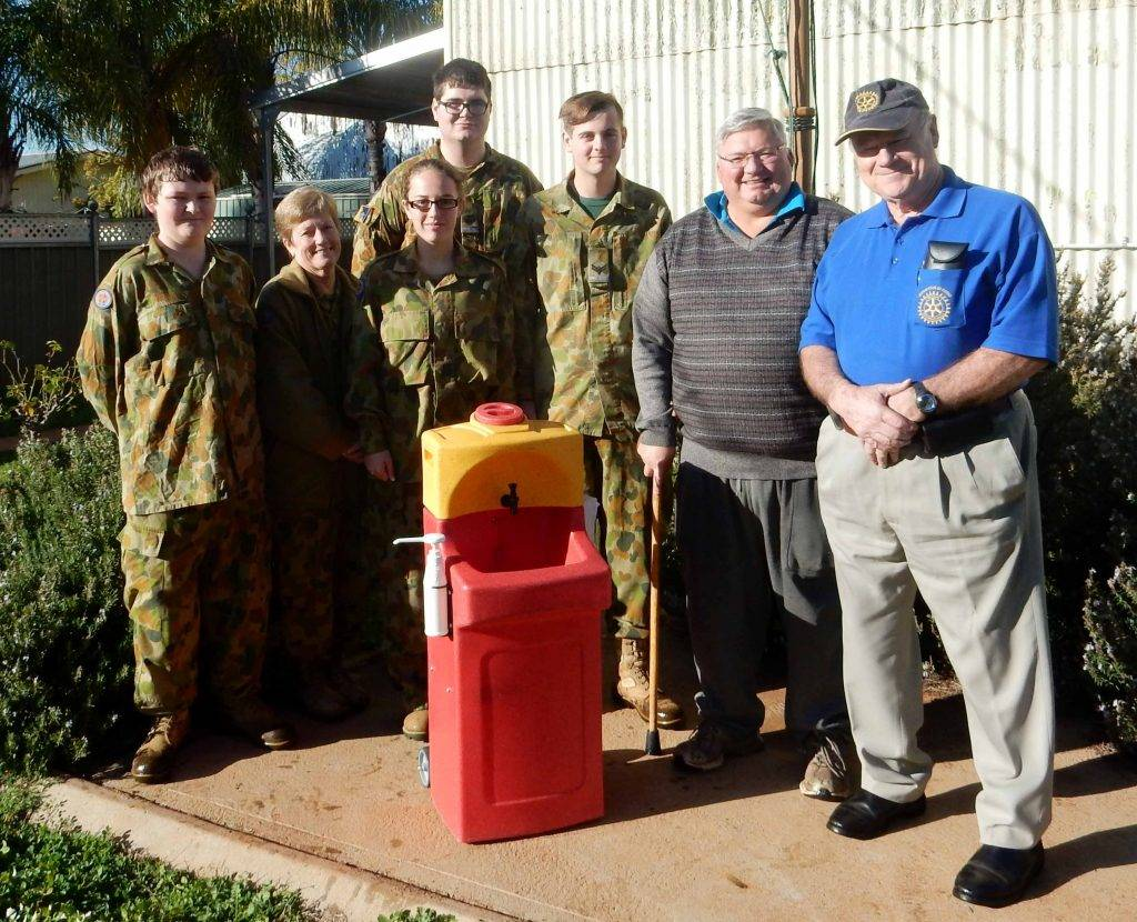 Cobar Cadet Officer Captain Colleen Boucher (second from left) and Cobar Cadet  members with incoming Rotary Club of Cobar president Tony Punzet and club past  president Gordon Hill at the recent handover of the portable hand washing station.