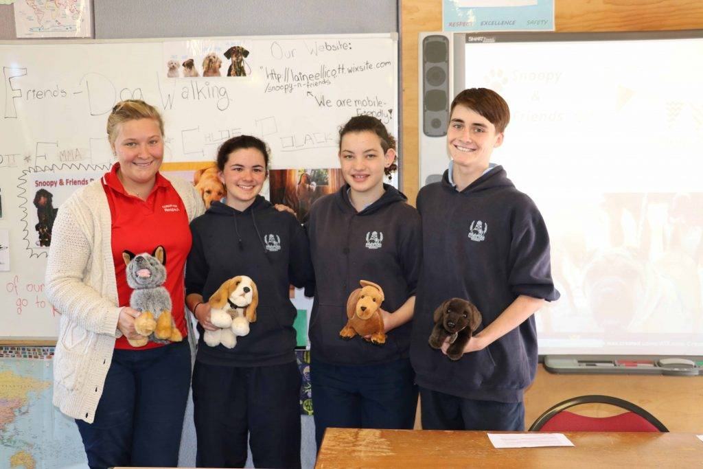 Cobar High School Year 9\10 Commerce students Chloe Polack, Emma Connelly and Laine Ellicott presented their dog walking business idea to the 'Yabby Tank' panel of  teachers and local business people on Monday at the school. The students are pictured with their teacher Samantha Dixon.