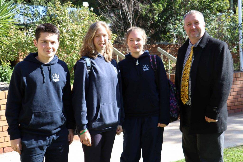Exchange students, Felix Bertin from France, Beatrice Villata from Italy and Tanja  Hörnig from Germany with acting deputy principal John Carswell at Cobar High School.