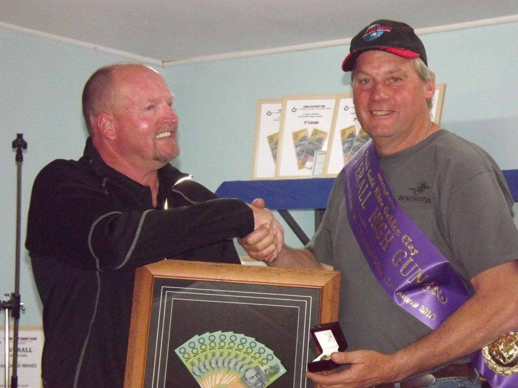 Peak Gold Mines general manager Greg Bowkett presenting Rob Thompson with the Overall High Gun winners prize of a 9ct gold trophy and cash at the Cobar Clay Target Club's 41st annual presentations on Sunday. ▪ Photo contributed