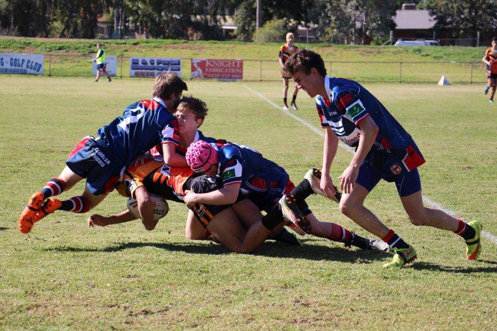 The Cobar 15/16s team started their match with some hard hitting tackles against  Nyngan on Saturday at Tom Knight Memorial Oval.