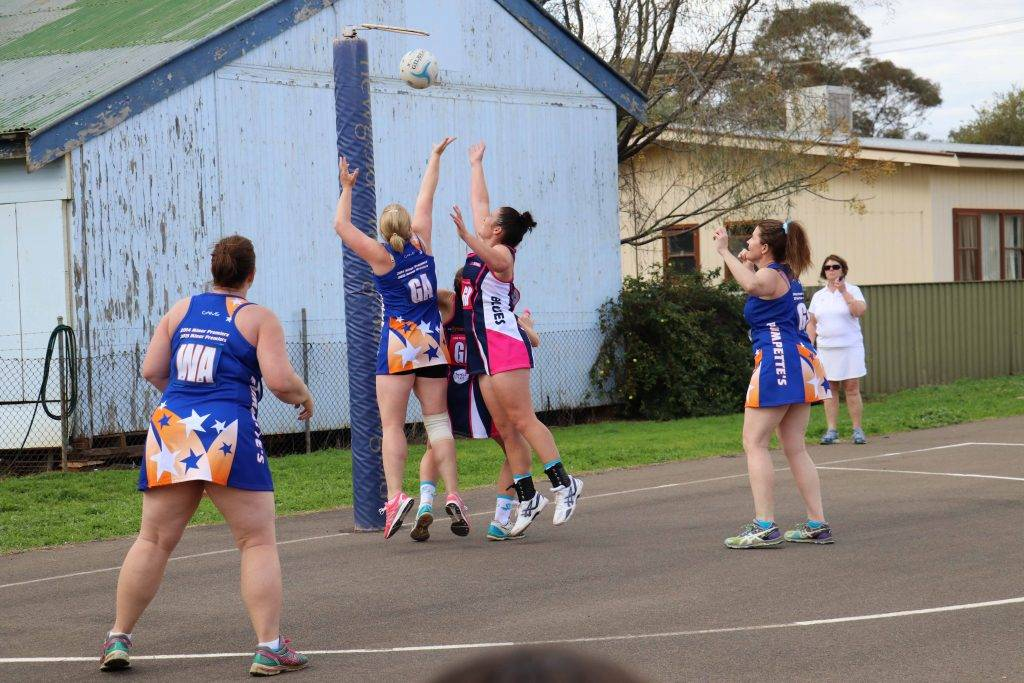 Pumpettes' shooters and Opens defenders look for the rebound in Saturday's A Grade netball final at the Ward Oval netball courts.